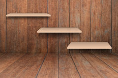 Three brown shelves on wooden interior texture background Stock Image