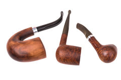 Three brown tobacco pipes Stock Image
