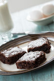 Three Brownies on a Plate With Eggs and a Cup of Milk Stock Photo
