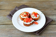 Three bruschetta with tomatoes Royalty Free Stock Images