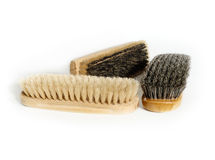 Three brushes. Old clothes-brushes and shoe-brush of natural materials Royalty Free Stock Photos