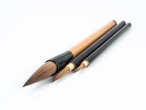 Three brushes. Three chinese brushes on white background stock image