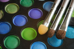 Three Brushes on the palette of eye shadow Royalty Free Stock Images