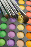 Three Brushes on the palette of eye shadows Stock Photography