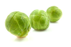 Three Brussels sprouts in a row Stock Image