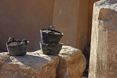 Three buckets. Work in progress at the Karnak temple complex, Egypt Stock Image