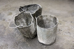 Three Buckets. Three Gray Buckets with Concrete Stock Images