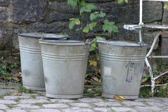 Three buckets Stock Photography