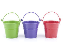 Three buckets of different colors Royalty Free Stock Image