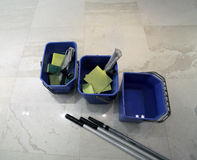 Three buckets with different tools for cleaning floor Royalty Free Stock Image