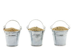 Three buckets filled with sand Stock Photos