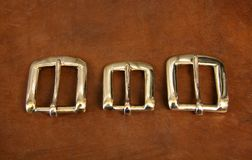 Three buckles on leather. Which will be made into belts Stock Images