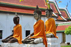 Three Buddha Brother at Wat Phra Borommathat Chaiya Temple Stock Photo