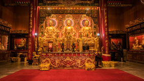 Three Buddha gold statue chinese style and chinese art architecture in Wat Leng Nei Yee Chinese temple. Stock Photography