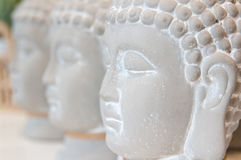 Three Buddha heads. Made of gypsum, for sale in a home interior articles shop stock image