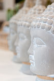 Three Buddha heads. Made of gypsum, for sale in a home interior articles shop royalty free stock photography