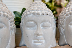 Three Buddha heads. Made of gypsum, for sale in a home interior articles shop stock photo