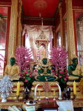 The three Buddha statues in green glass with gold dress Stock Images