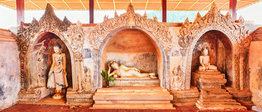 Three Buddha statues at Takhaung Mwetaw Paya in Sankar. Stock Photo