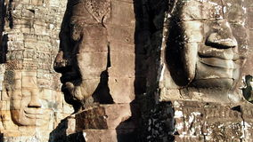 Three Buddhas. Three Buddha Faces at Prasat Bayon at Angkor Archeological Park, Cambodia Stock Images