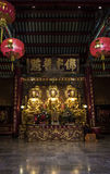 The three Buddhas in the Chinese temple of Thailand Stock Photography