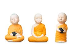 Three Buddhist monk statue. Group of young Buddhist monk statue on white background, Isolated Royalty Free Stock Photos