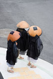Three buddhist monks. In Kobe, Japan Stock Photo