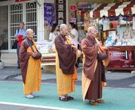Three Buddhist Monks Chant Scriptures Stock Image