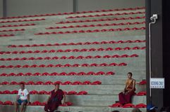 Three buddhist monks in purple clothes. Sitting in the audience stock images