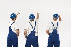 Three builders making a renovation Royalty Free Stock Photography