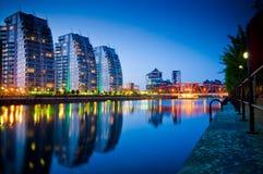 three buildings and bridge salford quays stock photos