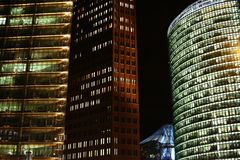 Three buildings at night Royalty Free Stock Images