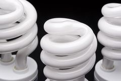 Three bulb head. Close up of three compact fluorescent bulb head Royalty Free Stock Photography