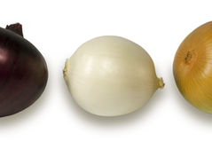 Three bulbs. Of onions: red, white, yellow. On a white background Stock Photography