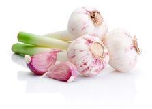 Three bulbs of fresh garlic and pieces  on white Royalty Free Stock Photos