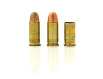 Three bullets. Side view of three gold colored bullets isolated on white background Royalty Free Stock Image