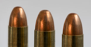 Three Bullets. Three 9mm bullets lined up in a row Stock Photos