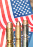 Three bullets on US flag background Stock Images