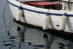 Three bumpers on a boat. Three bumpers reflected in the water Stock Photo