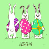 Three bunny rabbits holding Easter eggs Stock Photography