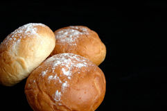 Three buns. Three delicious buns on black background Royalty Free Stock Image