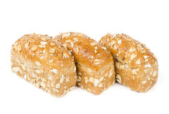 Three buns with oats Stock Photography