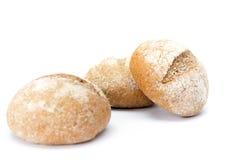 Three buns sprinkled with flour Royalty Free Stock Photos