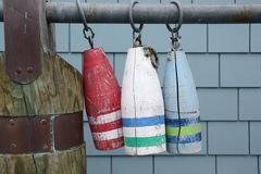 Three Buoys. Hanging from a metal pole Stock Images