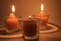 Three buring candles stock photography