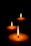 Three Burning candles. (focus on front candle Royalty Free Stock Image