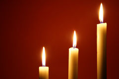 Three burning candles Stock Images