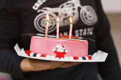 Three burning candles on the pink bithday cake Stock Photography