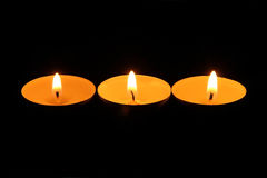 Three burning candles in a row Royalty Free Stock Photo