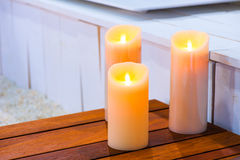 Three burning candles on Stock Photos